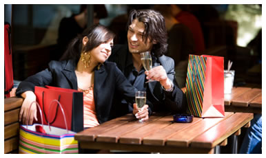 Photograph of a couple relaxing in a bar after shopping